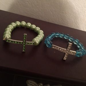 2 beaded cross bracelets.
